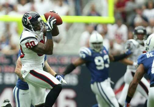 Houston Texans receiver Andre Johnson catches a pass against the Indianapolis Colt during the first quarter of a NFL game, Sunday, Sept. 11, 2011, in Reliant Stadium in Houston. Photo: Nick De La Torre, Houston Chronicle / © 2011 Houston Chronicle
