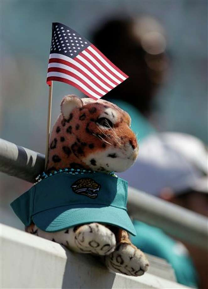 A stuff Jaguar left on a railing by a fan prior to an NFL football game between the Jacksonville Jaguars and the Tennessee Titans, Sunday, Sept. 11, 2011, in Jacksonville, Fla. (AP Photo/John Raoux) Photo: Associated Press