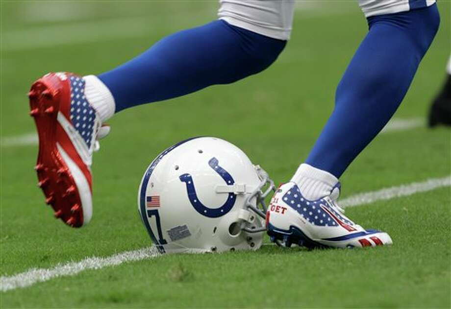 Indianapolis Colts' Reggie Wayne wears shoes commemorating the World Trade Center deaths before an NFL football game Sunday, Sept. 11, 2011, in Houston. (AP Photo/David J. Phillip) Photo: Associated Press