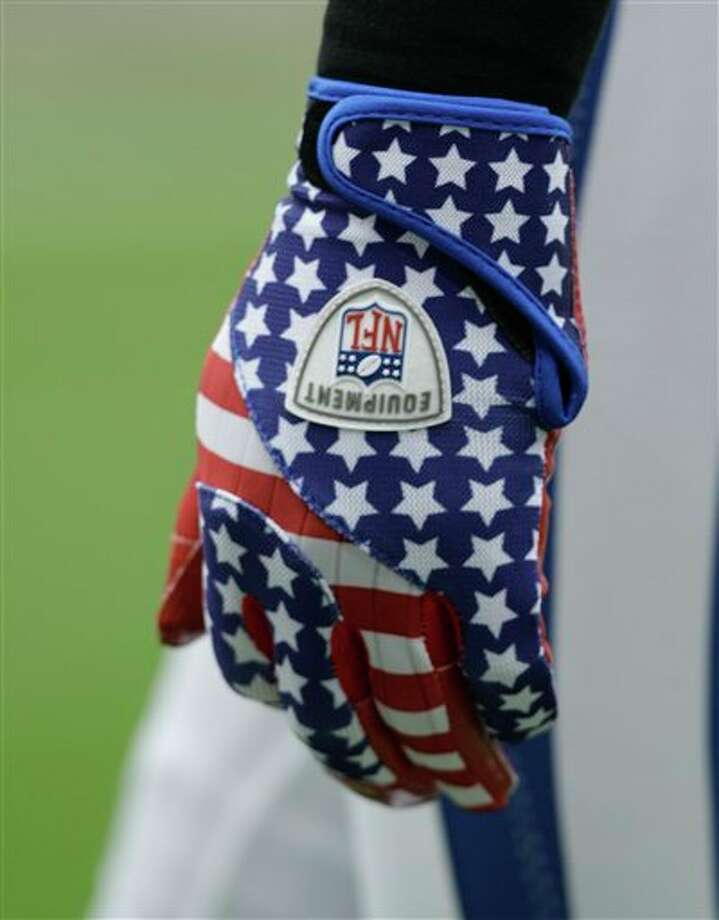 Indianapolis Colts'  Antoine Bethea wears gloves commemorating the World Trade Center deaths before an NFL football game Sunday, Sept. 11, 2011, in Houston. (AP Photo/David J. Phillip) Photo: Associated Press