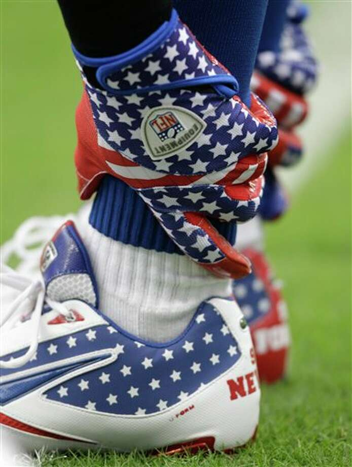 Indianapolis Colts'  Antoine Bethea wears gloves and shoes commemorating the World Trade Center deaths before an NFL football game Sunday, Sept. 11, 2011, in Houston. (AP Photo/David J. Phillip) Photo: Associated Press