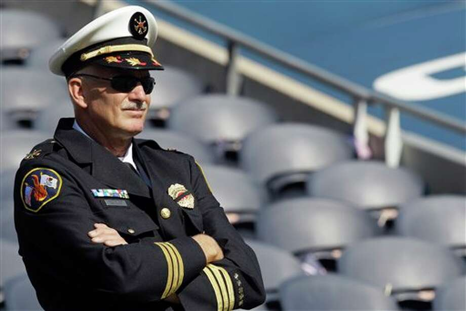 Barrington, Ill., Assistant Fire Chief Greg Keegan looks over Soldier Field on the 10th anniversary of the Sept. 11 attacks before an NFL football game between the Chicago Bears and Atlanta Falcons, Sunday, Sept. 11, 2011, in Chicago. (AP Photo/Nam Y. Huh) Photo: Associated Press