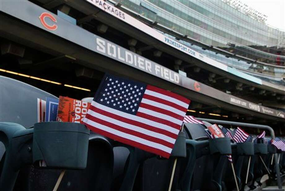 Miniature American flags are seen at each seat at Soldier Field on the 10th anniversary of the Sept. 11 attacks before an NFL football game between the Chicago Bears and Atlanta Falcons, Sunday, Sept. 11, 2011, in Chicago. (AP Photo/Charles Rex Arbogast) Photo: Associated Press