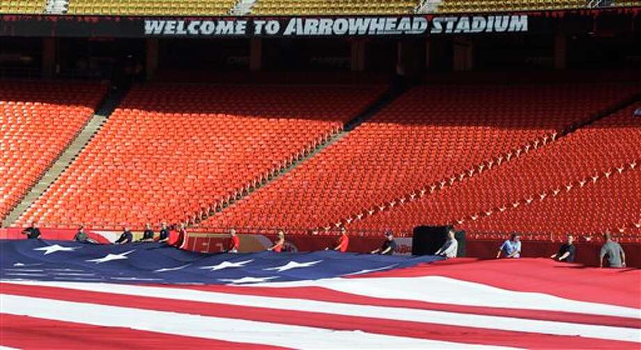 Emergency responders hold an American flag while practicing before an NFL football game between the Buffalo Bills and Kansas City Chief at Arrowhead Stadium in Kansas City, Mo., Sunday, Sept. 11, 2011. (AP Photo/Orlin Wagner) Photo: Associated Press