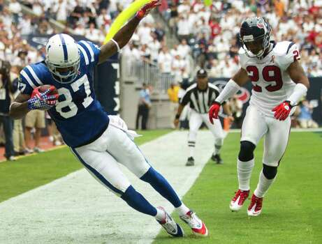 Indianapolis Colts wide receiver Reggie Wayne (87) beats Houston Texans defensive back Glover Quin (29) for a 6-yard touchdown reception during the fourth quarter of an NFL football game at Reliant Stadium Sunday, Sept. 11, 2011, in Houston. The Texans beat the Colts 34-7. Photo: Brett Coomer, Houston Chronicle / © 2011 Houston Chronicle