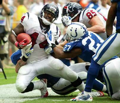 Houston Texans running back Ben Tate (44) is knocked out of bounds by Indianapolis Colts defensive back Jacob Lacey (27) during the fourth quarter of an NFL football game at Reliant Stadium Sunday, Sept. 11, 2011, in Houston. The Texans beat the Colts 34-7. Photo: Brett Coomer, Houston Chronicle / © 2011 Houston Chronicle
