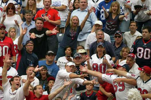 Houston Texans fans reach of a pass by Indianapolis Colts quarterback Kerry Collins (5) that went into the stands during the fourth quarter of an NFL football game at Reliant Stadium on Sunday, Sept. 11, 2011, in Houston. Photo: Smiley N. Pool, Houston Chronicle / © 2011  Houston Chronicle