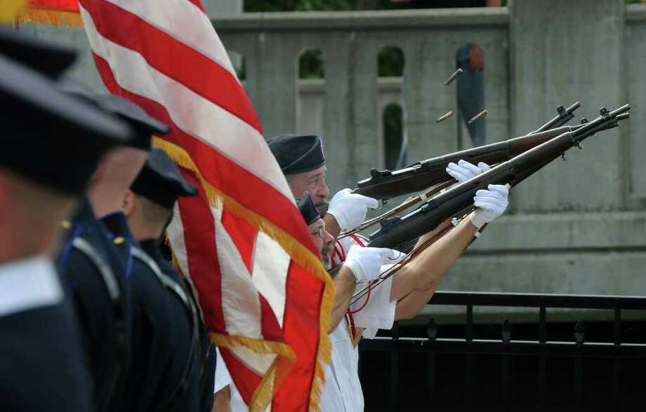 Members of the Veterans of Lansingburgh Honor Guard rifle squad fire a salute during the Celebration of Freedom, the dedication and memorial service of the Troy Sept. 11 Memorial at 112th Street and First Avenue on Sunday Sept. 11, 2011, in Troy, NY.  ( Philip Kamrass / Times Union) Photo: Philip Kamrass / 00014568A