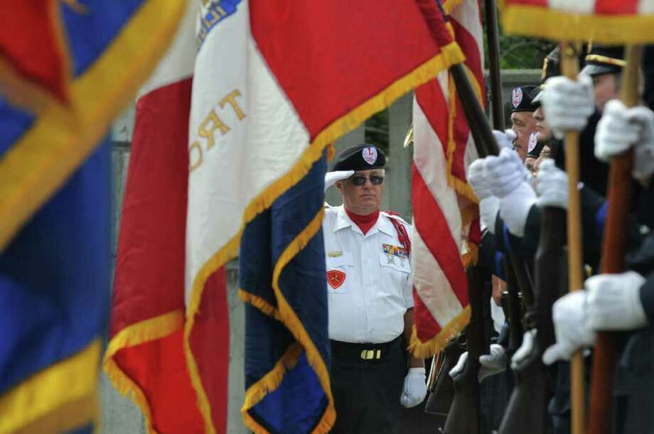 Bill Atchinson, a Vietnam War veteran with the U.S. Marine Corps,  salutes fellow members of the Veterans of Lansingburgh Honor Guard  during the Celebration of Freedom, the dedication and memorial service of the Troy Sept. 11 Memorial at 112th Street and First Avenue on Sunday Sept. 11, 2011, in Troy, NY.  ( Philip Kamrass / Times Union) Photo: Philip Kamrass / 00014568A