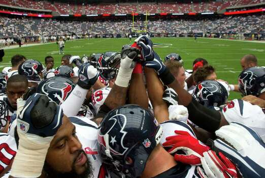 Houston Texans players huddle before facing the Indianapolis Colts in an NFL football game at Reliant Stadium Sunday, Sept. 11, 2011, in Houston. Photo: Brett Coomer, Houston Chronicle / © 2011 Houston Chronicle