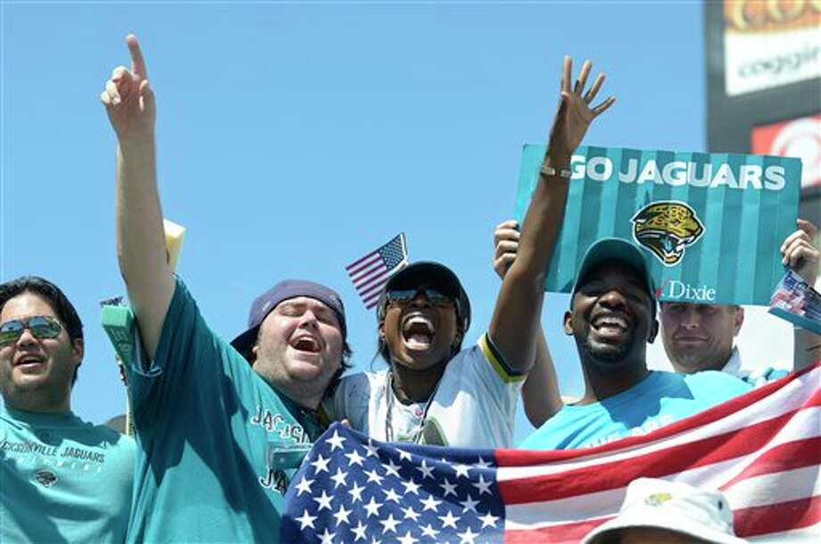 Jacksonville Jaguars fans cheer during the second half of an NFL football game against the Tennessee Titans in Jacksonville, Fla., Sunday, Sept. 11, 2011.(AP Photo/Phelan M. Ebenhack) Photo: Associated Press