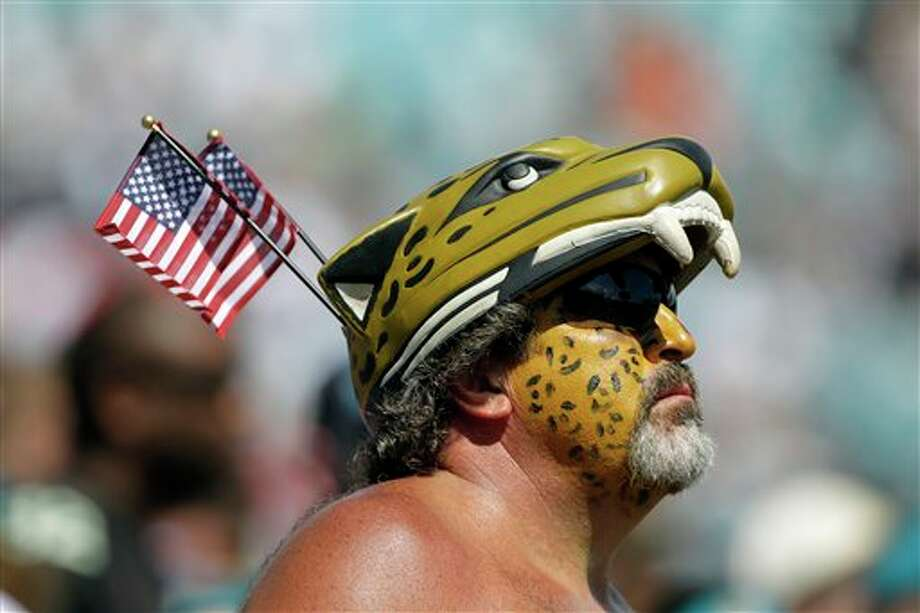 A Jacksonville Jaguars fan watches the second half of an NFL football game against the Tennessee Titans, Sunday, Sept. 11, 2011, in Jacksonville, Fla. Jacksonville won 16-14.(AP Photo/John Raoux) Photo: Associated Press