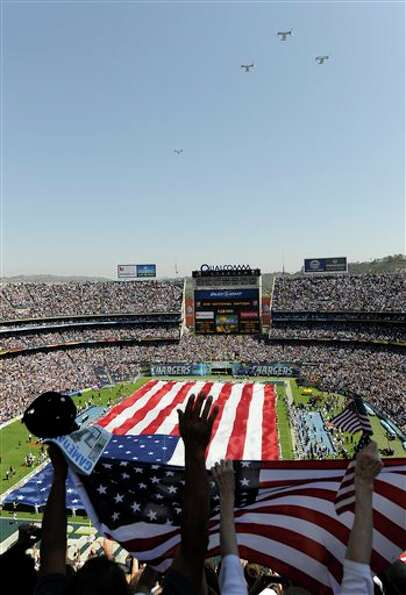 Osprey fly over Qualcomm Stadium  during a tribute for the tenth anniversary of Sept. 11 before the