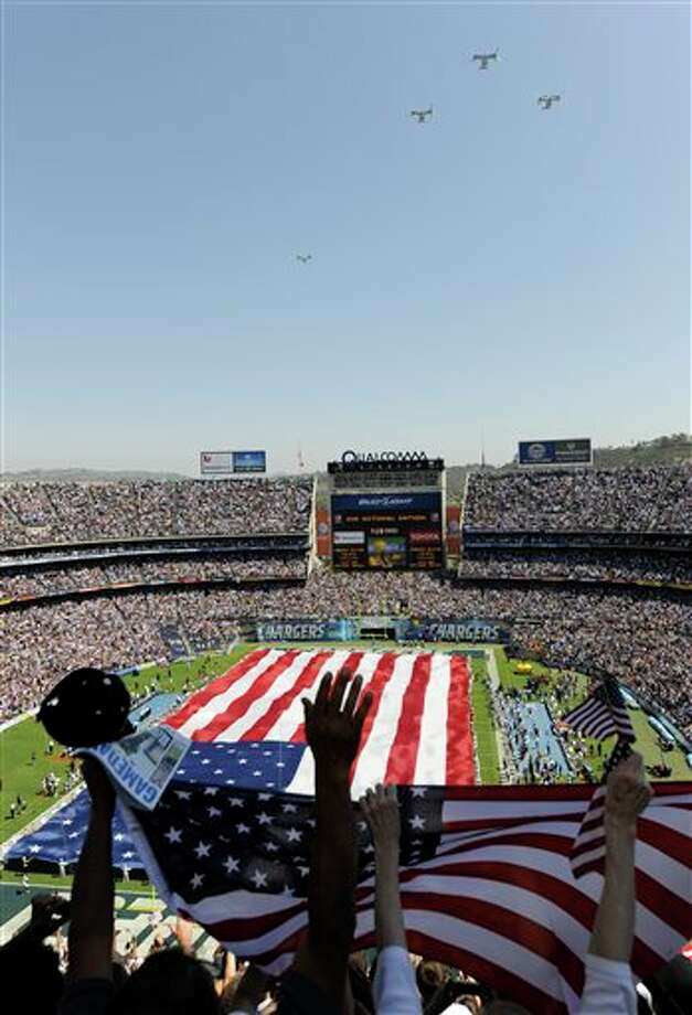Osprey fly over Qualcomm Stadium  during a tribute for the tenth anniversary of Sept. 11 before the San Diego Chargers face the Minnesota Vikings in an NFL football game Sunday, Sept. 11, 2011, in San Diego.  (AP Photo/Tracy Gitnick) Photo: Associated Press
