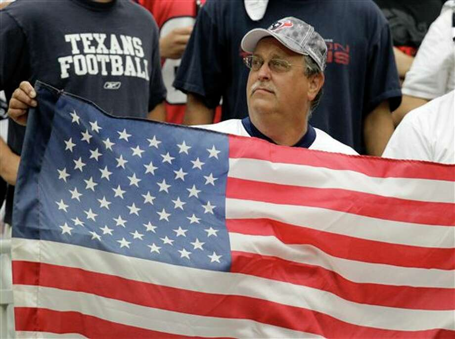 A Houston Texans fan during pregame in the first quarter of an NFL football game Sunday, Sept. 11, 2011, in Houston. (AP Photo/Eric Gay) Photo: Associated Press