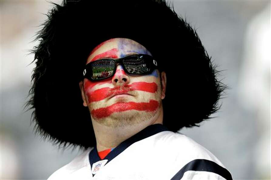 A Houston Texans fan before an NFL football game against the Indianapolis Colts Sunday, Sept. 11, 20