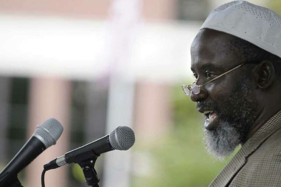"Imam A. Yaki of the Islamic Center of the Capital District, recites a passage from the Quran during a 9/11 Interfaith Service entitled ""Schenectady Remembers: Moving Toward Peace"" held at Veteran?s Park on Sunday, Sept. 11, 2011 in Schenectady.   (Paul Buckowski / Times Union) Photo: Paul  Buckowski  / 00014576A"