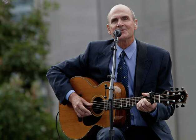 James Taylor performs during a ceremony to mark the 10th anniversary of the Sept. 11 attacks at the site of the World Trade Center in New York Sunday, Sept. 11, 2011. (AP Photo/Allan Tannenbaum, Pool) Photo: Allan Tannenbaum