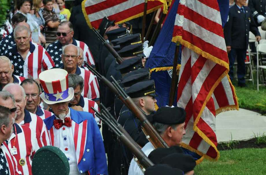 The  honor guard during the Celebration of Freedom, the dedication and memorial service of the Troy September 11th Memorial at 112th Street and First Avenue on Sunday Sept. 11, 2011 in Troy, NY.  The Uncle Sam Chorus makes their way to their position for the ceremony, at left.  ( Philip Kamrass / Times Union) Photo: Philip Kamrass / 00014568A