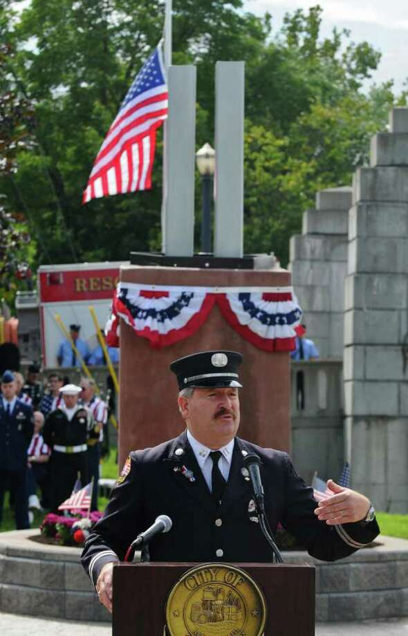 Retired Troy Fire Department Captain Gary Favro speaks about working at Ground Zero  after 9/11/01,  during the Celebration of Freedom, the dedication and memorial service of the Troy September 11th Memorial at 112th Street and First Avenue on Sunday Sept. 11, 2011 in Troy, NY.  ( Philip Kamrass / Times Union) Photo: Philip Kamrass / 00014568A