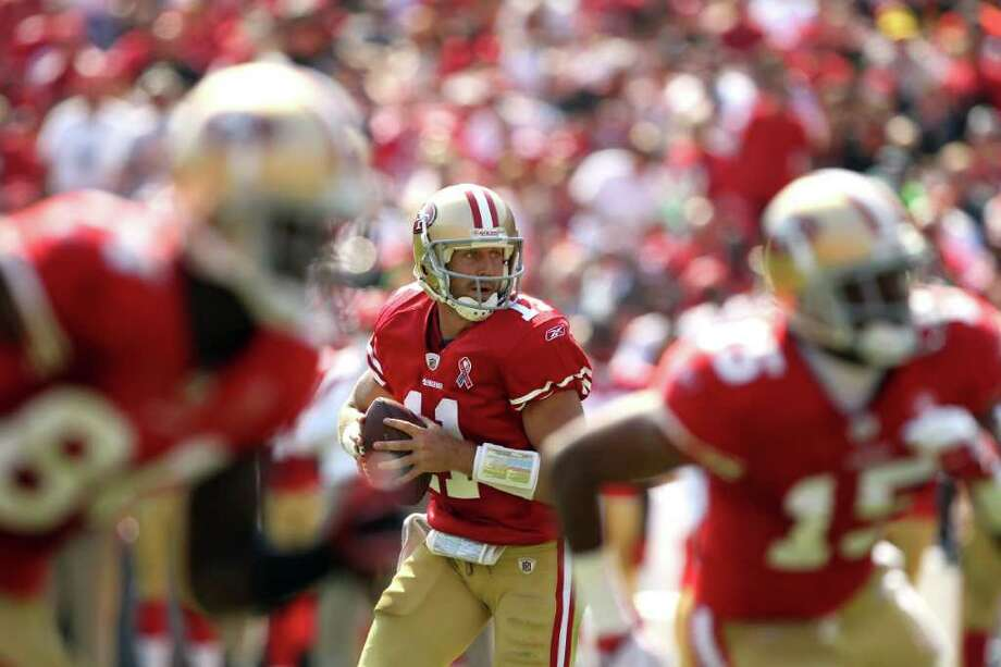 Alex Smith #11 of the San Francisco 49ers looks to pass the ball against the Seattle Seahawks. Photo: Ezra Shaw, Getty Images / 2011 Getty Images