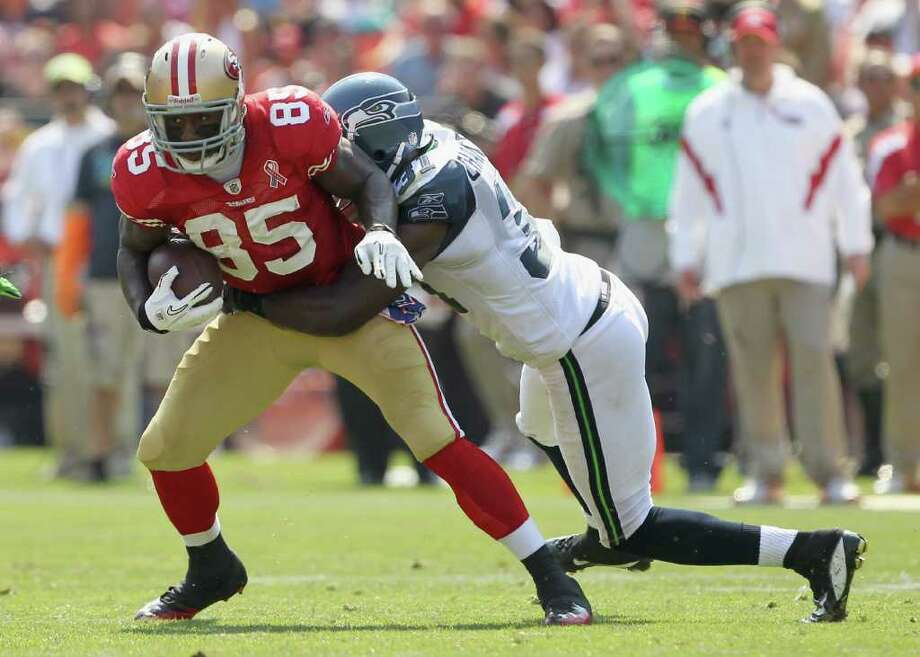 Vernon Davis #85 of the San Francisco 49ers is tackled by Kam Chancellor #31 of the Seattle Seahawks. Photo: Ezra Shaw, Getty Images / 2011 Getty Images