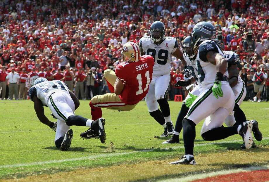 Alex Smith #11 of the San Francisco 49ers runs in for a touchdown against the Seattle Seahawks. Photo: Ezra Shaw, Getty Images / 2011 Getty Images