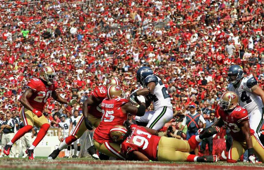 Marshawn Lynch #24 of the Seattle Seahawks is tackled by the San Francisco 49ers. Photo: Ezra Shaw, Getty Images / 2011 Getty Images