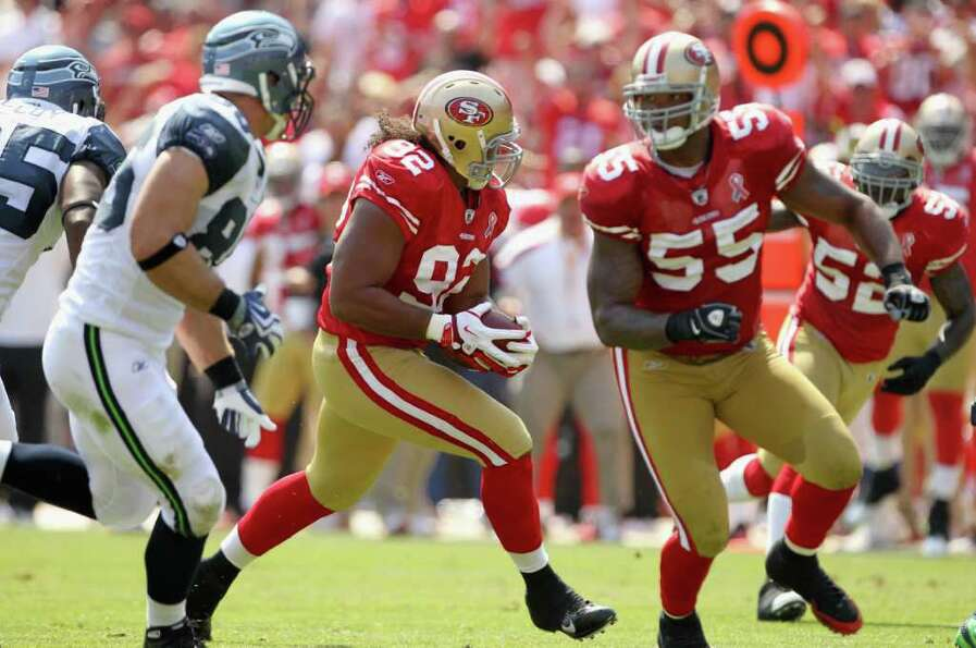 Will Tukuafu #92 of the San Francisco 49ers runs back an interception against the Seattle Seahawks.
