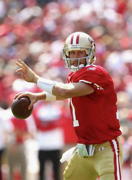Alex Smith #11 of the San Francisco 49ers looks to pass the ball against the Seattle Seahawks.
