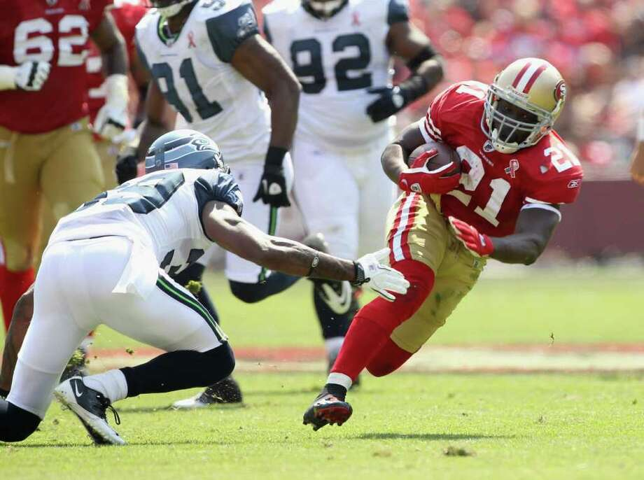 Frank Gore #21 of the San Francisco 49ers runs with the ball against the Seattle Seahawks. Photo: Ezra Shaw, Getty Images / 2011 Getty Images
