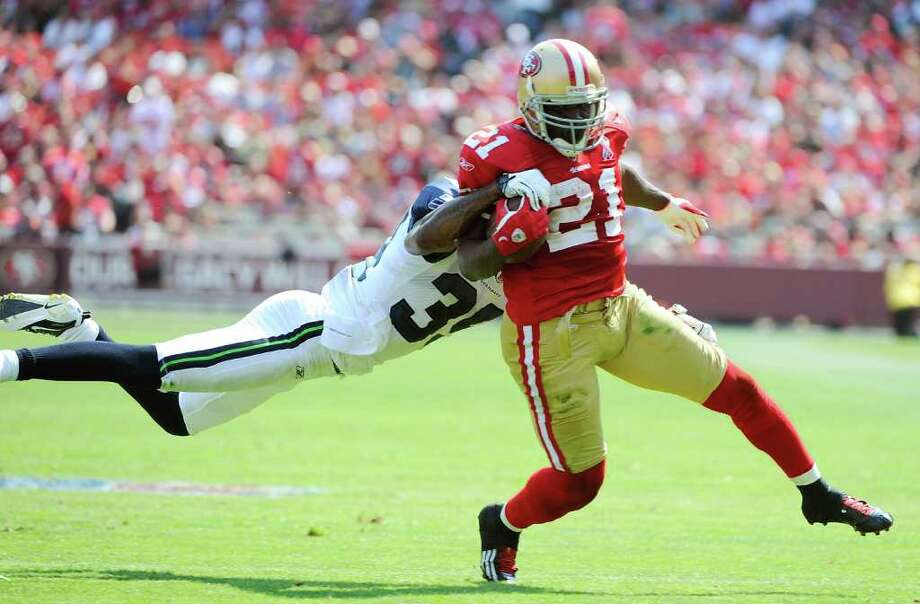 Frank Gore #21 of the San Francisco 49ers tries to break the tackle of Brandon Browner #39 of the Seattle Seahawks in the second quarter. Photo: Thearon W. Henderson, Getty Images / 2011 Getty Images