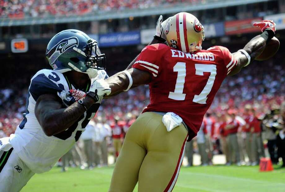 Brandon Browner #39 of the Seattle Seahawks is called for pass interference in the end zone on Braylond Edwards #17 of the San Francisco 49ers. Photo: Thearon W. Henderson, Getty Images / 2011 Getty Images