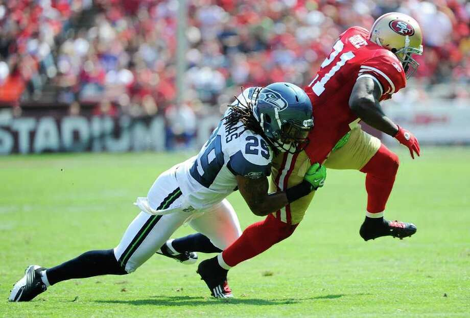 Frank Gore #21 of the San Francisco 49ers tries to run out of the grip of Earl Thomas #29 of the Seattle Seahawks in the second quarter. Photo: Thearon W. Henderson, Getty Images / 2011 Getty Images