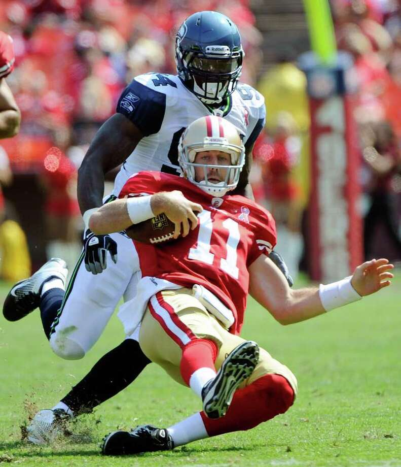 Alex Smith #11 of the San Francisco 49ers scrambles eleven yards for a first down against the Seattle Seahawks in the second quarter. Photo: Thearon W. Henderson, Getty Images / 2011 Getty Images