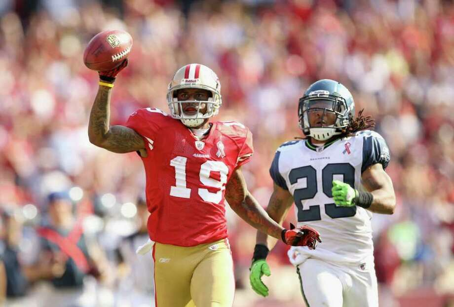 Ted Ginn #19 of the San Francisco 49ers outruns Earl Thomas #29 of the Seattle Seahawks on his way to scoring a touchdown on a kickoff return. Photo: Ezra Shaw, Getty Images / 2011 Getty Images
