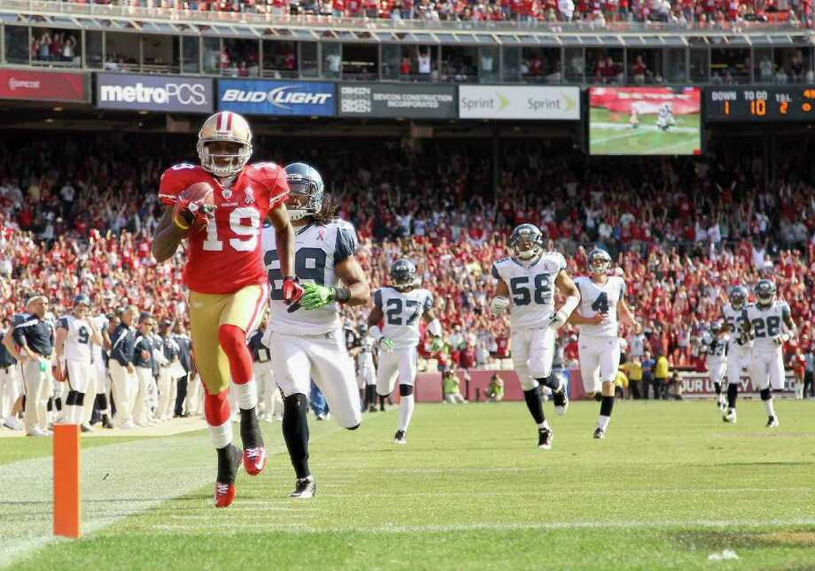 Ted Ginn #19 of the San Francisco 49ers outruns Earl Thomas #29 and the rest of the Seattle Seahawks on his way to scoring a touchdown on a kickoff return. Photo: Ezra Shaw, Getty Images / 2011 Getty Images