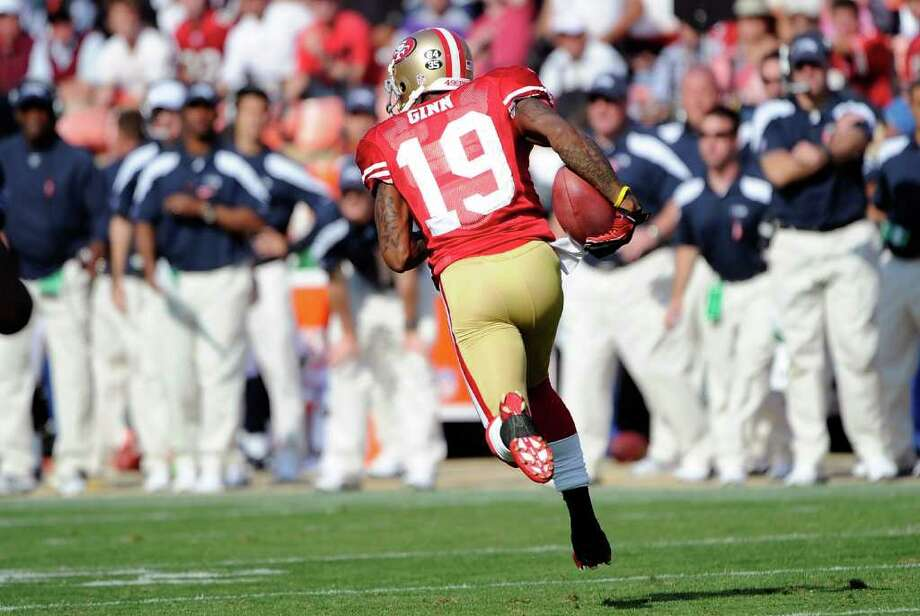 Ted Ginn Jr. #19 of the San Francisco 49ers returns a kick off 103 yards for a touchdown against the Seattle Seahawks in the fourth quarter. Photo: Thearon W. Henderson, Getty Images / 2011 Getty Images