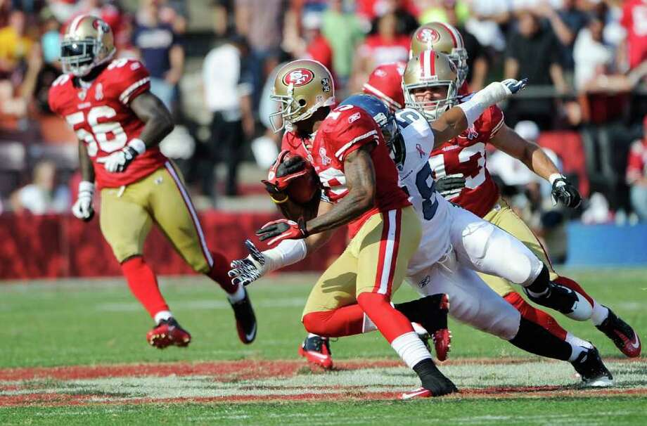 Ted Ginn Jr. #19 of the San Francisco 49ers gets away from Leroy Hill #56 of the Seattle Seahawks to return a punt 56 yards for a touchdown in the fourth quarter. Photo: Thearon W. Henderson, Getty Images / 2011 Getty Images
