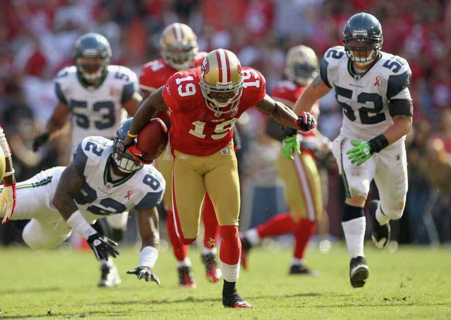 Ted Ginn #19 of the San Francisco 49ers breaks a tackle on his way to returning a punt for a touchdown. Photo: Ezra Shaw, Getty Images / 2011 Getty Images