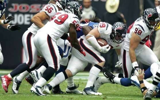 Houston Texans defensive end J.J. Watt (99) picks up a fumble by Indianapolis Colts quarterback Kerry Collins for a turnover during the first half of an NFL football game at Reliant Stadium Sunday, Sept. 11, 2011, in Houston. The Texans beat the Colts 34-7. Photo: Brett Coomer, Houston Chronicle / © 2011 Houston Chronicle