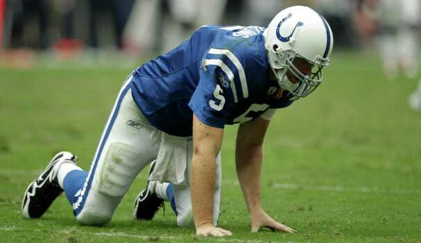 Indianapolis Colts quarterback Kerry Collins gets off the turf after being hit by Houston Texans linebacker Mario Williams during the third quarter of an NFL football game at Reliant Stadium Sunday, Sept. 11, 2011, in Houston. Photo: Brett Coomer, Houston Chronicle / © 2011 Houston Chronicle