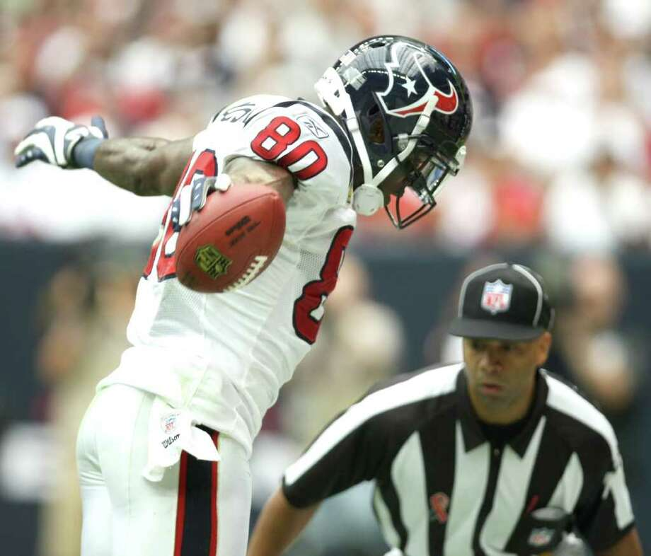 Houston Texans wide receiver Andre Johnson (80) and a referee look down to make sure he has both feet inbounds on a touchdown catch during the third quarter of a NFL game against the Indianapolis Colts, Sunday, Sept. 11, 2011, at Reliant Stadium in Houston. Photo: Nick De La Torre, Houston Chronicle / © 2011 Houston Chronicle
