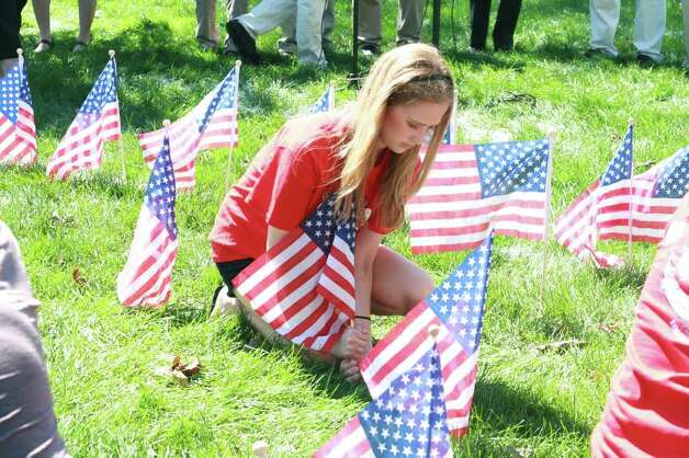 Fairfield University hosts a ceremony for the tenth anniversary of 9/11 and remembers the victims of the attacks. Photo: Loan Le / Hearst Connecticut Media Group