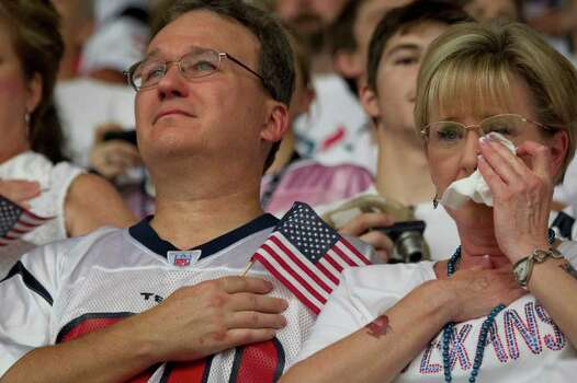 Houston Texans fan  Cheri Gibbs of Friendswood wipes away as she and her husband Bill observe a moment of silence in remembrance of those who died in the September 11, 2001 terrorist attacks before an NFL football game against the Indianapolis Colts at Reliant Stadium on Sunday, Sept. 11, 2011, in Houston. Photo: Smiley N. Pool, Houston Chronicle / © 2011  Houston Chronicle
