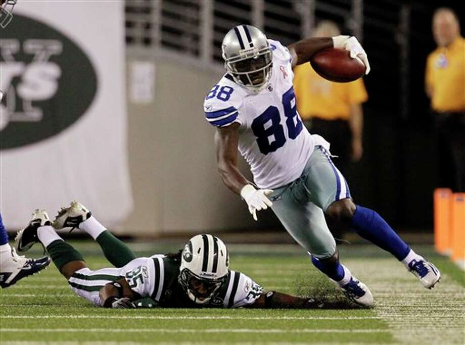 Dallas Cowboys wide receiver Dez Bryant (88) is driven out of bounds by New York Jets Isiah Trufant during the first half of an NFL football game Sunday, Sept. 11, 2011, in East Rutherford, N.J. (AP Photo/Julio Cortez) Photo: Associated Press
