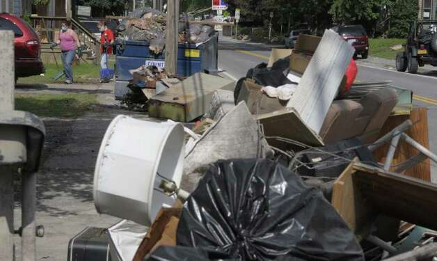 Items are thrown away on the curb in downtown Rotterdam Junction as the cleanup from the flooding continued on Sunday, Sept. 11, 2011.   (Paul Buckowski / Times Union) Photo: Paul Buckowski  / 00014585A