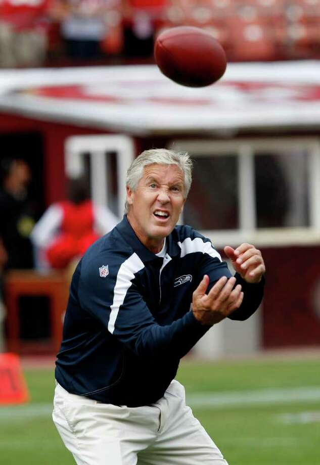 Pete Carroll, the Seahawks head coach played catch before the start of the contest. San Francisco 49ers in action against the Seattle Seahawks Sunday September 11, 2011 at Candlestick Park. Photo: Brant Ward, The Chronicle / ONLINE_YES