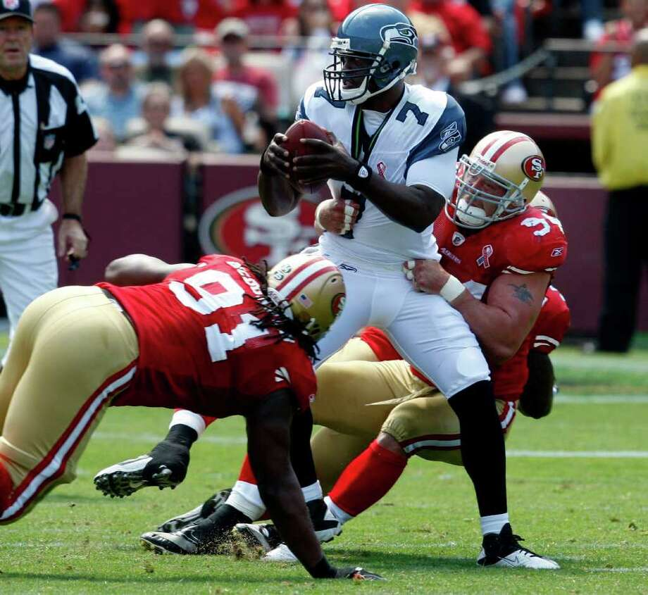 The San Francisco defense takes down Seahawks quarterback Tavaris Jackson in the second half. The San Francisco 49ers defeat the Seattle Seahawks 33-17 at Candlestick Park Sunday September 11, 2011. Photo: Brant Ward, The Chronicle / ONLINE_YES