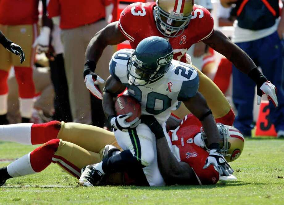 Justin Forsett of the Seahawks is stopped for a short gain in the first half. The San Francisco 49ers defeat the Seattle Seahawks 33-17 at Candlestick Park Sunday September 11, 2011. Photo: Brant Ward, The Chronicle / ONLINE_YES
